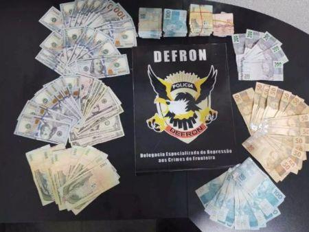 Foram apreendidos R$ 20.126,00, US$ 2.831,00 e 15.450.000,00 guaranis (moeda paraguaia). (Foto: Divulgação PCMS)